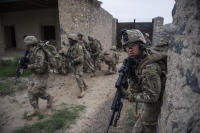 Members of the US Armys 1st Infantry Division search a building in Eastern Afghanistan.