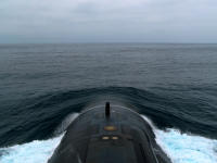 The Los Angeles-class attack submarine USS Helena (SSN 725) transits the North Pacific Ocean, having departed from Naval Base Point Loma in San Diego.