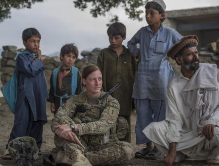 Narizah, Khost Province, Afghanistan- A US Army sergeant assigned to the 1st Infantry Division participates in a meeting with village elders and local children in eastern Afghanistan. The Afghan culture is one of tribes and personal relationships. ISAF personnel must build strong personal relationships with the leaders of the cities in which they work in order to accomplish the mission in Afghanistan.