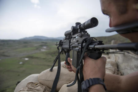 Sabari District, Afghanistan- A Solder from the U.S. Armys 1st Battalion, 26th Infantry Regiment scans the area around his base while testing a newly-fielded rifle system. Called the Blue Spaders, the 26th Infantry Regiment was founded in 1901, and has served in World War I, World War II, Vietnam, and the Global War on Terror. 