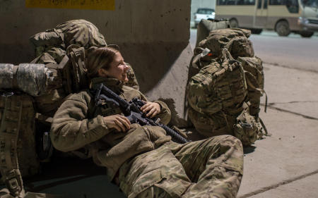 US Army Captain Julie Snyder of the 212 Infantry awaits an available seat on a flight from Bagram Airfield, Afghanistan. 