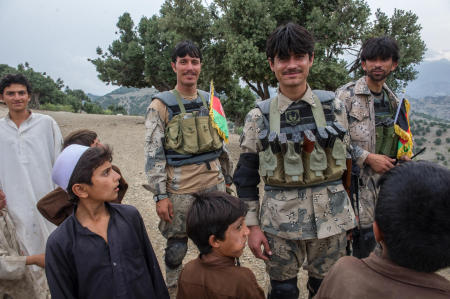 Members of the Afghan Border Police share a laugh with local children during a patrol in eastern Afghanistan. ABP officers patrol a 55 km-wide corridor along the entirety of Afghanistan's border, secure international airports, administer immigration services, and handle anti-narcotic efforts.